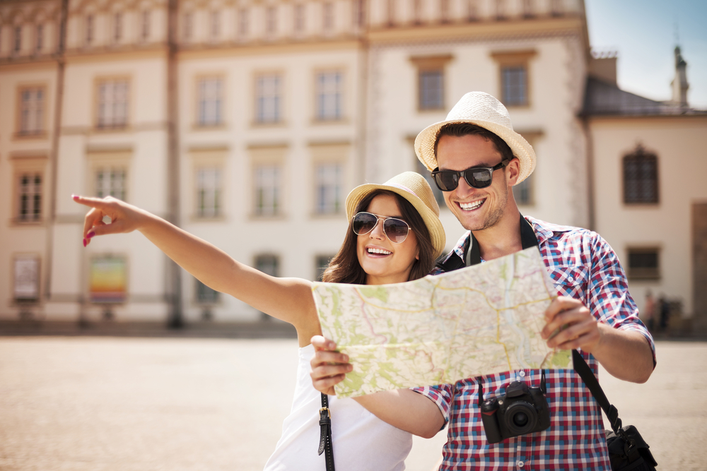 couple holding up a map
