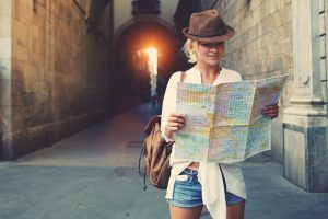 woman looking at map while traveling