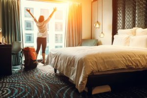 girl stretching inside a hotel room