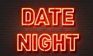 sign that says date night